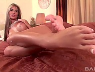 Elegant blonde gives footjob to a man, takes a cock in anal hole and helps him cum using her legs 11