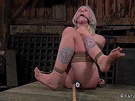 Pervert tied blonde-haired prisoner so that every her movement excited her erogenous zones 10