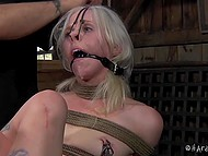 Pervert tied blonde-haired prisoner so that every her movement excited her erogenous zones 11