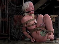 Pervert tied up blonde-haired prisoner so that every her movement excited her erogenous zones 5