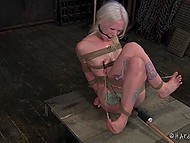Pervert tied blonde-haired prisoner so that every her movement excited her erogenous zones