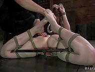 Dominating man thoroughly tied up damsel and began to rub her slits with different sex toys 6