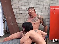 German whore doesn't fear to be spotted by bystanders riding middle-aged man's cock among garages 7