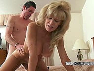 Mature woman with giant boobs still remembers how to bed younger comrade in XXX video 8