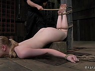Using a special BDSM device tied up blonde's ass is getting penetrated by big black dildo 3