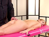 Masseur in black rubbed clean-shaven flower of winning client with nimble fingers 4
