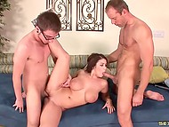 Two penises easily pleased luxurious MILF with massive hooters in the threesome scene