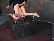 Tied redhead gets punished by whip, micro vibrator in her cunt and a big black dildo 11