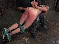 Young sportswoman was caught by lustful male, who spanked hard her round butt