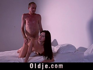 Attractive colleen with slender body convinced old man to visit bedroom and make pink pussy feel good