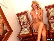Naked masturbatrix makes herself comfortable on carved chairs and set her vibrating friend to maximum power 11