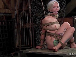 Tied woman with white hair has to sit motionless because otherwise her nipples will get in trouble