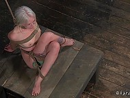 Tied woman with white hair has to sit motionless because otherwise her nipples will get in trouble 4