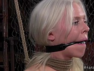 Tied woman with white hair has to sit motionless because otherwise her nipples will get in trouble 6
