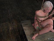 Tied woman with white hair has to sit motionless because otherwise her nipples will get in trouble 8