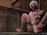 Tied woman with white hair has to sit motionless because otherwise her nipples will get in trouble 9