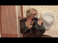 Blonde MILF in black stockings finds a surprise in gloryhole room that can satisfy her hunger for cum 4