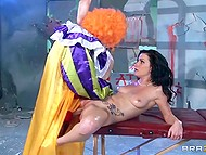 Black-haired hottie was dreaming of coition with clown and one day he screwed her on the couch 4