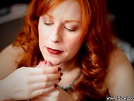 Red-haired sweetheart with red lips performed tender blowjob to man sitting in the chair 6