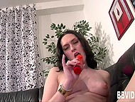 Dark-haired masturbatrix now fingers her shaved vagina, now uses favorite toy to impale it 6