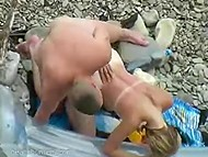 Tanned young couple expected nobody to see them copulating on the rocky beach 4