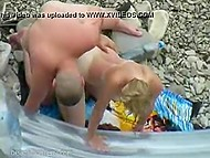 Tanned young couple expected nobody to see them copulating on the rocky beach 6