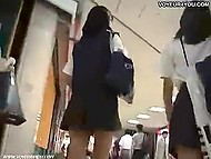 Insolent guy with camera tries to look up skirts of three Asian schoolgirls in the mall 4