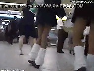 Insolent guy with camera tries to look up skirts of three Asian schoolgirls in the mall 7