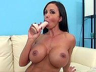 Uninhibited MILF with hot jugs starts to masturbate her cunt and uses for that white dildo and fingers 5