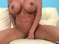 Uninhibited MILF with hot jugs starts to masturbate her cunt and uses for that white dildo and fingers 9