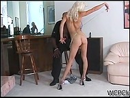 Delectable pornstar with long legs serves immense black dick in doggystyle position 5