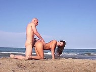 Bald macho roughly penetrated buxom dame and made her squirt on secluded beach 8