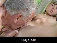 Teen girl decides to engage old man so she undresses and starts to give a blowjob in the garden 7