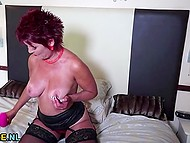 Mature dame in stockings poses, undresses and stimulates her pierced pussy with vibrator 6