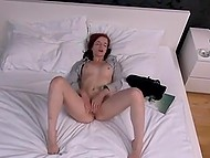 Fiery-red girl from Poland stretches her pussy with speculum and rubs clitoris with vibrator