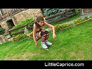 Enchantress Little Caprice likes to travel with roller skates and fondle neat flower sitting on the grass 4
