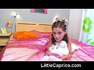 Czech babe Little Caprice likes to play with piglet plush toy and mischievous fingers 6