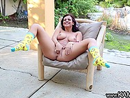 Tootsie exposed natural breasts and spread her legs widely to finger pussy under the canopy 10