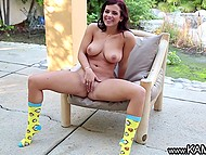 Tootsie exposed natural breasts and spread her legs widely to finger pussy under the canopy 11
