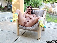 Tootsie exposed natural breasts and spread her legs widely to finger pussy under the canopy 8