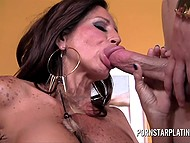Experienced MILF Tara Holiday engages young man and uses his cock to appease her sexual hunger 11