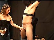Tied man likes to feel helpless in hands of frolicsome MILF who is stroking his boner 3