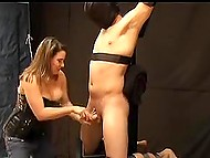 Tied man likes to feel helpless in hands of frolicsome MILF who is stroking his boner