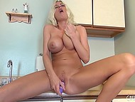 Having washed all her plates, lonely housewife pleases herself in the kitchen 11