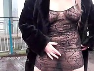 Blonde in fur coat and see-through chemise pees and pets the kitty in public places 5