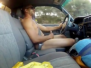 Naked male is able to drive his car through city jerking penis off at the same time