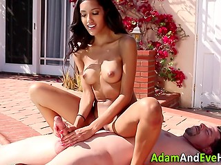 Entrancing Latina with slender body gave boy awesome footjob and handjob in the open air