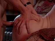 Impassioned sex of alluring babe and her paramour in their favorite bed next to fireplace 5