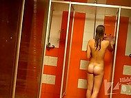 Hidden camera set in shower room captured young girl washing thin body and hairy pussy