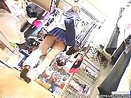 Curious man looks up Asian schoolgirl's skirt while she is choosing underwear 9
